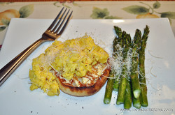Herbed Cheese Scrambled Eggs on Asparagus